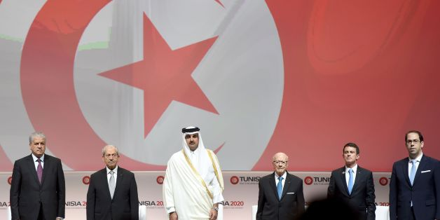 (LtoR) Algerian Prime Minister Abdelmalek Sellal: Tunisian Assembly President Mohamed Ennaceur; the Emir of Qatar, Tamim bin Hamad al-Thani; Tunisian President Beji Caid Essebsi, French Prime Minister Manuel Valls and Tunisian Prime Minister Youssef Chahed (R) stand on stage during the opening ceremony of the 'Tunisia 2020' international investment conference on November 29, 2016 in Tunis. 