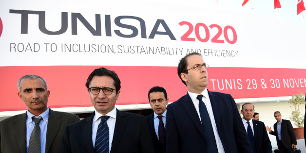 Tunisian Prime Minister Youssef Chahed (R) and Tunisia's Investment and International Cooperation Minister Fadhel Abdelkefi (C) arrive to inspect the final preparation at the Congress Palace in the capital Tunis, on November 27, 2016, two days ahead of the opening ceremony of the 'Tunisia 2020' conference. Tunisia will host 2,000 business and finance executives from 40 countries this week in hopes of drumming up investment to boost its struggling economy. / AFP / FETHI BELAID        (Photo credit should read FETHI BELAID/AFP/Getty Images)
