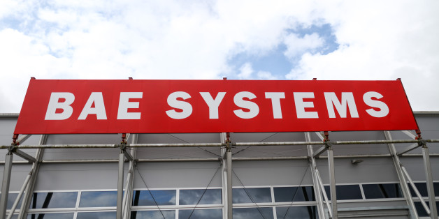 The BAE Systems Plc logo stands on display on the second day of the Farnborough International Airshow 2016 in Farnborough, U.K., on Tuesday, July 12, 2016. The air show, a biannual showcase for the aviation industry, runs until July 17. Photographer: Simon Dawson/Bloomberg via Getty Images