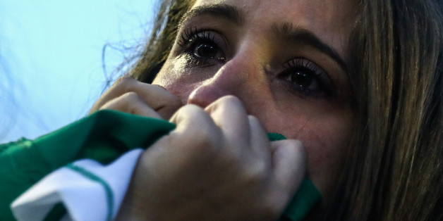 CHAPECO, BRAZIL - NOVEMBER 30:  A fan cries while paying tribute to the players of Brazilian team Chapecoense Real at the club's Arena Conda stadium in Chapeco, in the southern Brazilian state of Santa Catarina, on November 30, 2016. The players were killed in a plane accident in the Colombian mountains. Players of the Chapecoense team were among the 77 people on board the doomed flight that crashed into mountains in northwestern Colombia. Officials said just six people were thought to have surv