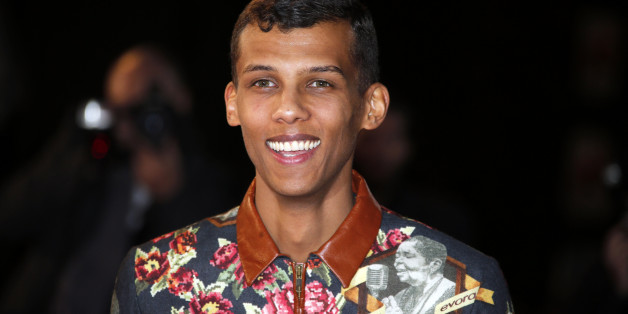 Belgian singer Stromae arrives for the NRJ Music Awards ceremony at the Festival Palace in Cannes December 13, 2014. REUTERS/Eric Gaillard (FRANCE  - Tags: ENTERTAINMENT)