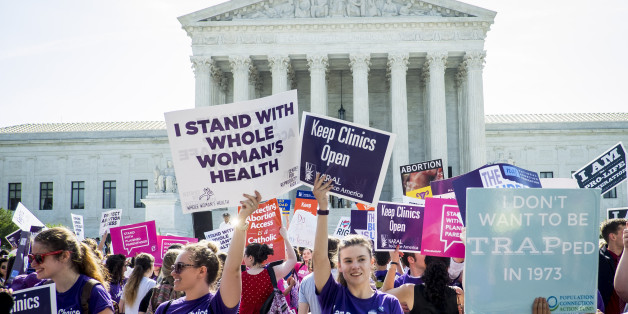 WASHINGTON, DC - JUNE 27:  Pro-choice and pro-life activists demonstrate on the steps of the United States Supreme Court on June 27, 2016 in Washington, DC. In a 5-3 decision, the U.S. Supreme Court struck down one of the nation's toughest restrictions on abortion, a Texas law that women's groups said would have forced more than three-quarters of the state's clinics to close. (Photo by Pete Marovich/Getty Images)