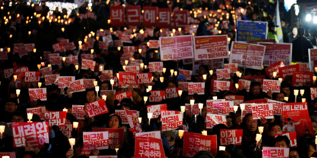 "People chant slogans during a protest calling for South Korean President Park Geun-hye to step down in central Seoul, South Korea, November 29, 2016. The sign reads ""Step down Park Geun-hye immediately"".  REUTERS/Kim Hong-Ji     TPX IMAGES OF THE DAY"