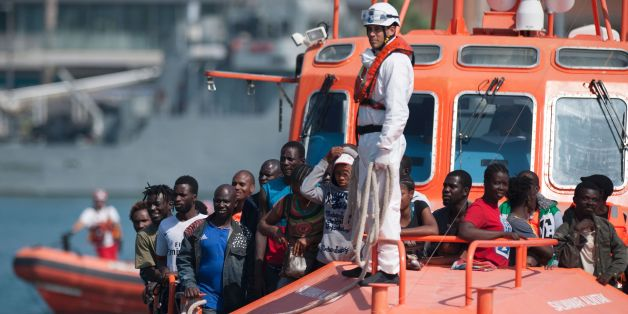 A group of migrants arrive on a Spanish coast guard vessel into the southern Spanish port of Malaga on August 31, 2016 after an inflatable boat carrying 52 Africans, nine of them women, was rescued by the Spanish coast guard off the Spanish coast. / AFP / JORGE GUERRERO        (Photo credit should read JORGE GUERRERO/AFP/Getty Images)