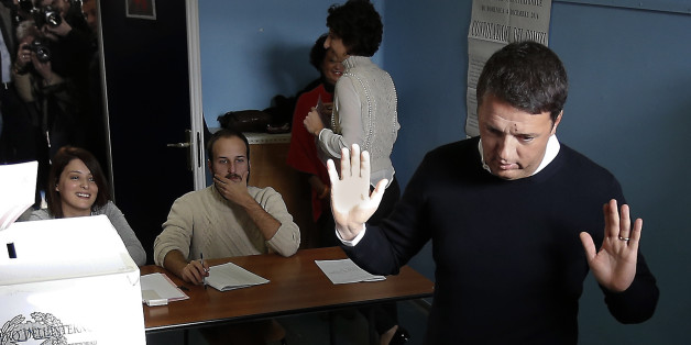 Italian Premier Matteo Renzi gesticulates after casting his ballot at a polling station in Pontassieve, Italy, Sunday, Dec. 4, 2016. Italians voted Sunday in a referendum on constitutional reforms that Premier Matteo Renzi has staked his political future on. Premier Matteo Renzi has said he would resign if the reforms are rejected in Sunday's vote, and opposition politicians have vowed to press for a new government if voters reject the proposed constitutional changes. (AP Photo/Antonio Calanni)