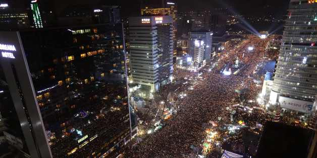 Protesters gather for a rally against South Korea's President Park Geun-hye in Seoul on December 3, 2016.Hundreds of thousands of protestors marched in Seoul for the sixth-straight week on December 3 to demand the ouster and arrest of scandal-hit Park ahead of an impeachment vote in parliament. / AFP / POOL / Chung Sung-Jun        (Photo credit should read CHUNG SUNG-JUN/AFP/Getty Images)
