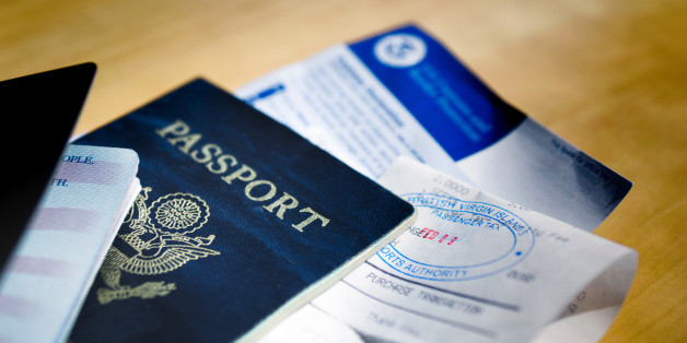 Two American passports with visa or tourist cards tucked inside all stamped and ready to go.g