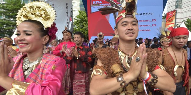 Indonesian dancers perform on a stage during a pro-government rally to call for unity in Jakarta on December 4, 2016. Thousands of people paraded in Indonesia's capital Jakarta on December 4, to call for unity and peace amid growing tensions in the society. / AFP / ADEK BERRY        (Photo credit should read ADEK BERRY/AFP/Getty Images)