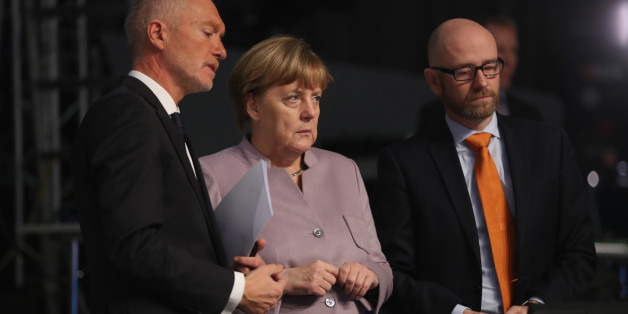 ESSEN, GERMANY - DECEMBER 05:  German Chancellor and Chairwoman of the German Christian Democrats (CDU) Angela Merkel, flanked by CDU spokesman Peter Tauber (R) and CDU managing director Klaus Schueler, views the hall where the CDU will hold its annual federal congress beginning tomorrow on December 5, 2016 in Essen, Germany. Over 1,000 CDU delegates will meet to debate and vote on the party's course for next year following the recent announcement by Merkel that she will run for a fourth term as chancellor in federal elections scheduled for next September.  (Photo by Sean Gallup/Getty Images)