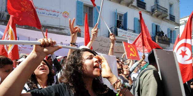 Tunisian workers from UGTT Tunisian General Labour Union shout slogans as they attend a May Day rally on May 1, 2014 in Tunis. AFP PHOTO / FETHI BELAID        (Photo credit should read FETHI BELAID/AFP/Getty Images)