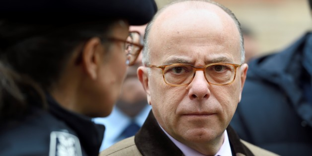 French Interior Minister Bernard Cazeneuve talks with a police chief as part of a visit focused on  security measures at Jewish schools on December 2, 2016 in Paris.  / AFP / ERIC FEFERBERG        (Photo credit should read ERIC FEFERBERG/AFP/Getty Images)