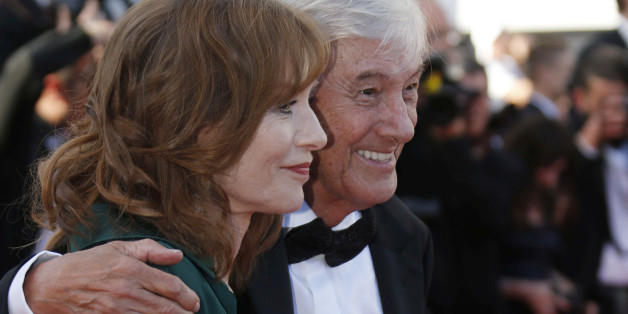 "Director Paul Verhoeven (R) and cast member Isabelle Huppert pose on the red carpet as they arrive for the screening of the film ""Elle"" in competition at the 69th Cannes Film Festival in Cannes, France, May 21, 2016. REUTERS/Regis Duvignau"