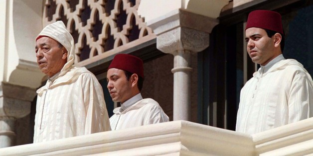 Moroccan King Hassan II (L) listens to the national anthem with his sons Crown Prince Sidi Mohammed and Moulay Rachid (R) at a ceremony at the royal palace in Rabat March 3. King Hassan marked his 37th anniversary of acceding to the throne on Tuesday.  MOROCCO
