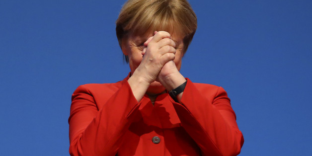 German Chancellor and leader of the conservative Christian Democratic Union party CDU Angela Merkel reacts after her speech at the CDU party convention in Essen, Germany, December 6, 2016.     REUTERS/Kai Pfaffenbach