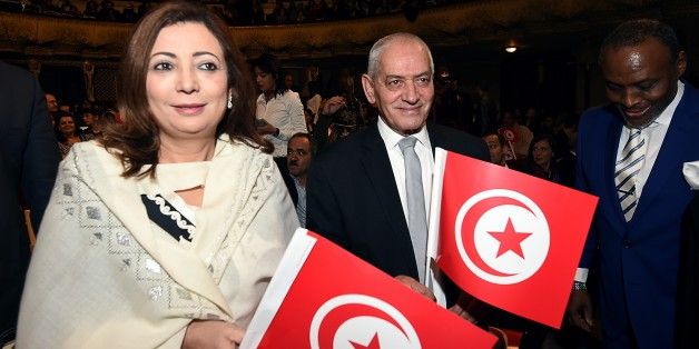 Nobel Peace Prize winners for 2015, Tunisian employers union (UTICA) pesident, Wided Bouchamaoui (L), and Tunisian General Labour Union (UGTT) general secretary, Houcine Abassi (R), arrive for the closing ceremony of the 26th Carthage Film Festival on November 28, 2015 in Tunis. AFP PHOTO / FETHI BELAID / AFP / FETHI BELAID        (Photo credit should read FETHI BELAID/AFP/Getty Images)