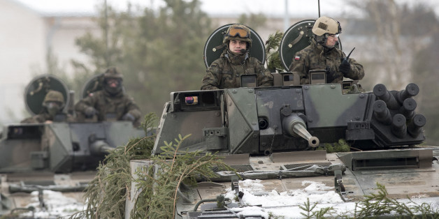 Polish Army soldiers take part in the NATO military exercise 'Iron Sword 2016' at a training range in Pabrade, north of the capital Vilnius, Lithuania on Friday, Dec. 2, 2016. The multinational exercise 'Iron Sword 2016' will train roughly 4,000 soldiers from 11 NATO allies. (AP Photo/Mindaugas Kulbis)