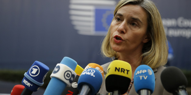 European foreign policy chief Federica Mogherini speaks to media reporters as she arrives for the EU summit in Brussels, Thursday, Oct. 20, 2016. British Prime Minister Theresa May will hold her first talks with European Union leaders and tell them that the U.K.'s decision to leave the bloc is irreversible. (AP Photo/Alastair Grant)