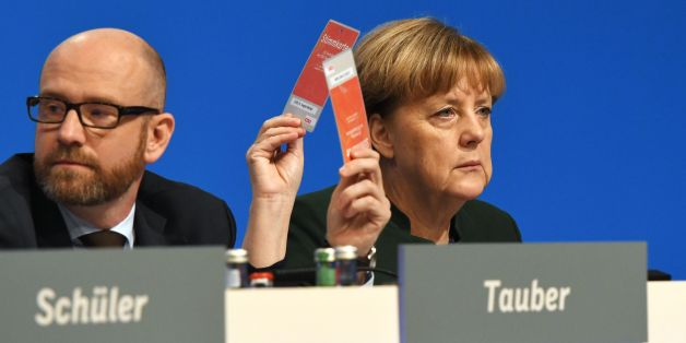 German Chancellor and Head of the Christian Democratic Union (CDU) Angela Merkel CDU Secretary General Peter Tauber vote during the party's congress in Essen, western Germany, on December 7, 2016.Party members gave Angela Merkel a standing ovation lasting more than 11 minutes but also dealt a blow in re-electing her as party chief with her worst score, 89.5 percent, since she became chancellor of Germany. / AFP / TOBIAS SCHWARZ        (Photo credit should read TOBIAS SCHWARZ/AFP/Getty Images)