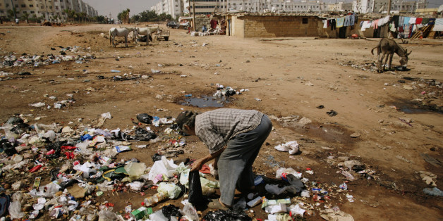 A man searches for food amongst garbage at Duar Skuila slum in Casablanca September 1, 2007. Hopelessness has the Casablanca shanty of Douar Escuela in its grip, Qadi Youssef said, and Friday's parliamentary election will do nothing to bring the jobs it desperately needs. Things have worsened since suicide bombings in March by young men from Douar Escuela, the same slum that was home to some of the Islamist militants who attacked Casablanca in 2003. Picture taken on September 1, 2007.  To match