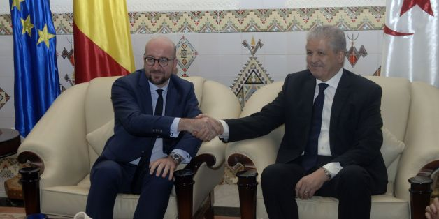 Belgian Prime Minister, Charles Michel (L) meets with Algerian Prime Minister Abdelmalek Sellal upon his arrival at the International Houari Boumediene airport outside the capital Algiers on December 6, 2016. / AFP / RYAD KRAMDI        (Photo credit should read RYAD KRAMDI/AFP/Getty Images)