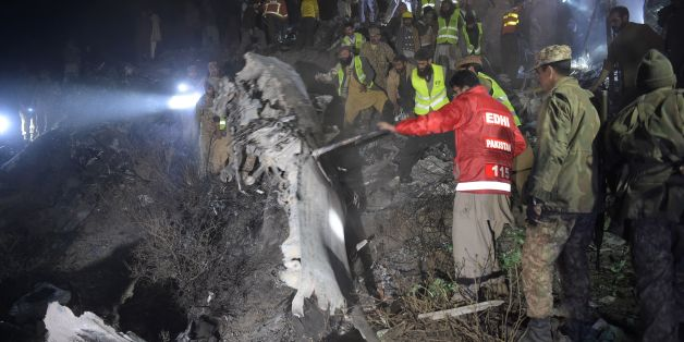 Pakistani soldiers and volunteers search for victims from the wreckage of the crashed PIA passenger plane Flight PK661 at the site in the village of Saddha Batolni in the Abbottabad district of Khyber Pakhtunkhwa province on December 7, 2016.A Pakistani plane carrying 48 people crashed on December 7, in the country's mountainous north and burst into flames killing everyone on board, authorities said, in one of the deadliest aviation accidents in the country's history. Pakistan International Airl