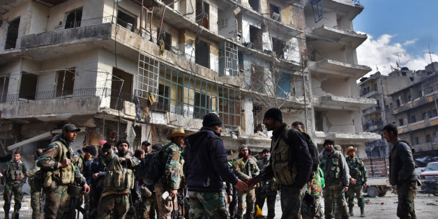 Syrian government troops gather as they patrol the al-Shaar neighbourhood after taking control of the area in the eastern part of the northern city of Aleppo on December 7, 2016.Rebels in Aleppo called for a five-day truce and the evacuation of civilians after losing more than three quarters of their territory including the Old City to a Syrian army offensive. / AFP / GEORGE OURFALIAN        (Photo credit should read GEORGE OURFALIAN/AFP/Getty Images)