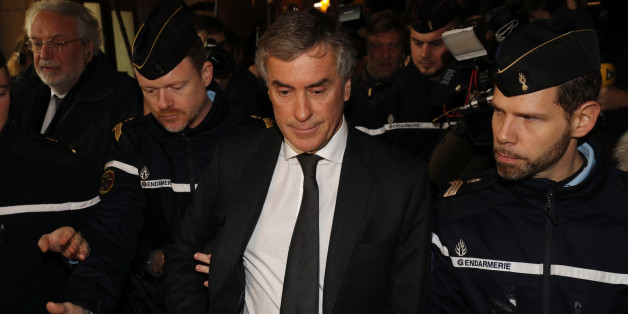 Former French budget minister Jerome Cahuzac, who resigned in 2013 after he admitted to having a Swiss bank account, is surrounded by French gendarmes as he leaves after the verdict in his tax fraud trial at the courtroom in Paris, France, December 8, 2016. Cahuzac was sentenced to three years in jail on Thursday for hiding an offshore bank account of his own.   REUTERS/Philippe Wojazer