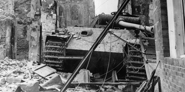World War II, A German 'Tiger' tank destroyed, in the ruins of Argentan (Normandy), In the back, the cathedral, August 20, 1944. (Photo by Photo12/UIG/Getty Images)