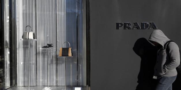 A man walks past a Prada store in Madrid, Spain, March 10, 2016. REUTERS/Susana Vera