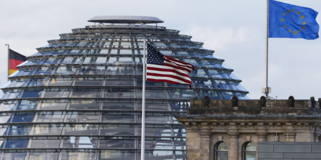 The flag on the U.S. embassy is pictured next to the Reichstag building, seat of the German lower house of parliament Bundestag, in Berlin October 28, 2013. A German newspaper said on Sunday that U.S. President Barack Obama knew his intelligence service was eavesdropping on Angela Merkel as long ago as 2010, contradicting reports that he had told the German leader he did not know  REUTERS/Tobias Schwarz (GERMANY  - Tags: POLITICS CITYSCAPE)