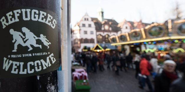 A sticker reading 'Refugees Welcome' is fixed on a pole on December 5, 2016 in Freiburg, southwestern Germany.The German government pleaded for calm after the arrest of a teenage Afghan asylum seeker for the alleged rape and murder of a German student in Freiburg triggered fresh criticism of the country's liberal refugee policy. / AFP / dpa / Patrick Seeger / Germany OUT        (Photo credit should read PATRICK SEEGER/AFP/Getty Images)