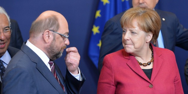 BRUSSELS, BELGIUM - MARCH 17: (R to L) German Chancellor Angela Merkel and President of European Parliament Martin Schultz talk together on the first day of two days longn European Union (EU) Summit at the Council of the European Union in Brussels, Belgium on March 17, 2016. (Photo by Dursun Aydemir/Anadolu Agency/Getty Images)