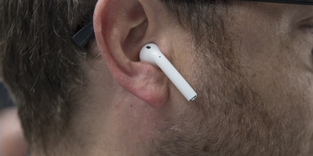 An attendee wears Apple Inc. AirPod wireless headphones during an event in San Francisco, California, U.S., on Wednesday, Sept. 7, 2016. Apple Inc. unveiled new iPhone models Wednesday, featuring a water-resistant design, upgraded camera system and faster processor, betting that after six annual iterations it can still make improvements enticing enough to lure buyers to their next upgrade. Photographer: David Paul Morris/Bloomberg via Getty Images