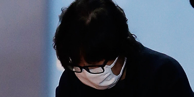 SEOUL, SOUTH KOREA - NOVEMBER 03:  Choi Soon-Sil, a confidant of South Korean President Park Geun-Hye, is to get on a bus of Ministry of Justice as she leaves the Seoul Central District Court on November 3, 2016 in Seoul, South Korea. The prosecutors was issued an arrest warrant for Choi Soon-sil for allegedly influencing state affairs and embezzling money by taking advantage of her close relationship with President Park Geun-hye.  (Photo by Korea Pool/Getty Images)