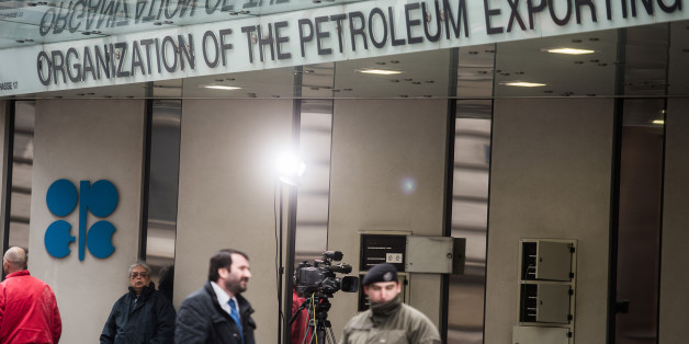 An OPEC logo sits on the wall as security and media stand outside of the OPEC Secretariat ahead of the 171st Organization of Petroleum Exporting Countries (OPEC) meeting in Vienna, Austria, on Tuesday, Nov. 29, 2016. An OPEC deal to curtail oil production appeared in jeopardy as Iran said it wont make cuts while Saudi Arabia insisted Tehran must be willing to play a meaningful role in any agreement. Photographer: Akos Stiller/Bloomberg via Getty Images