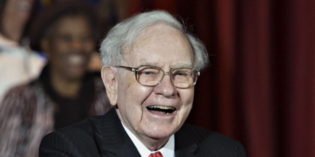 Warren Buffett, chairman and chief executive officer of Berkshire Hathaway Inc., smiles during an event with Hillary Clinton, former Secretary of State and 2016 Democratic presidential candidate, not pictured, at Sokol Auditorium in Omaha, Nebraska, U.S., on Wednesday, Dec. 16, 2015. Buffet said at the rally that he was supporting Clinton's bid for president because they share a commitment to help the less affluent. Photographer: Daniel Acker/Bloomberg via Getty Images