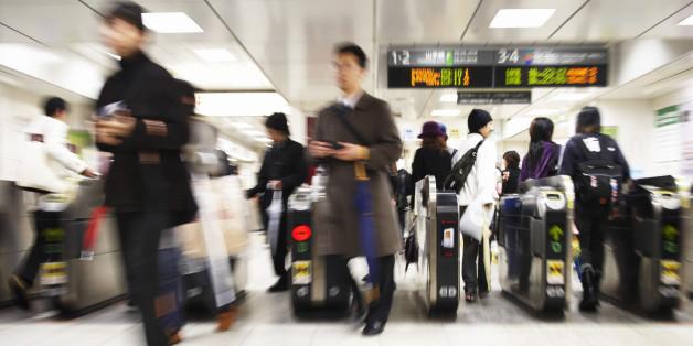 Commuters Walking Through Turnstiles, Japan