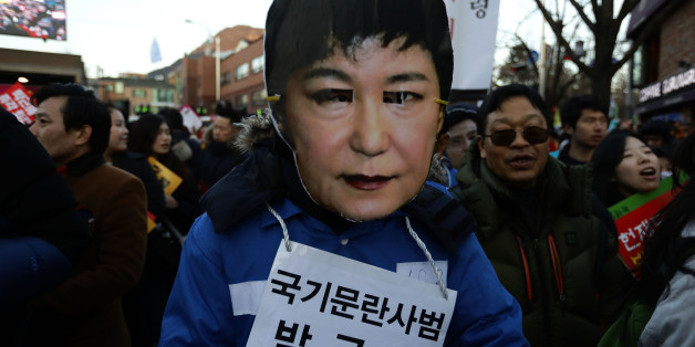 SEOUL, SOUTH KOREA - DECEMBER 10: Protesters wearing masks of South Korea's President Park Geun-Hye during a rally against South Korean President Park Geun-Hye on December 10, 2016 in Seoul, South Korea. The South Korean National Assembly voted yesterday for an impeachment motion at its plenary session, which will set up the rare impeachment trial for President Park over the accusation of corruption involving Park and her long time confidante.  (Photo by Chung Sung-Jun/Getty Images)