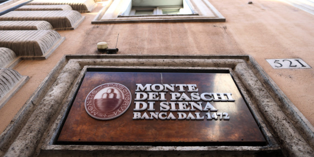A sign hangs above the entrance to a branch of Banca Monte dei Paschi di Siena SpA bank after the Italian vote on constitutional reform referendum in Rome, Italy, on Monday, Dec. 5, 2016. Banca Monte dei Paschi di Siena SpA shares seesawed on Monday after Prime Minister Matteo Renzis decision to resign added to uncertainty about the banks plans to raise as much as 5 billion euros ($5.3 billion) in capital by the end of the year. Photographer: Chris Ratcliffe/Bloomberg via Getty Images