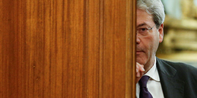 Italian Prime Minister-designate Paolo Gentiloni leaves at the end of a meeting at the Low Chamber in Rome, Italy December 12, 2016. REUTERS/Remo Casilli