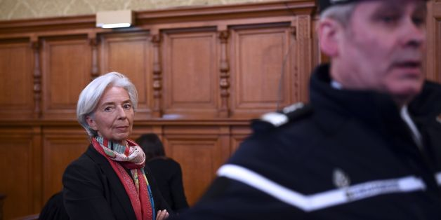 IMF chief Christine Lagarde is pictured in the courtroom at the Paris courthouse on December 12, 2016 prior to the start of her trial before the Court of Justice of the Republic, a special tribunal used to try ministers. IMF chief Christine Lagarde goes on trial in France on December 12 over a massive state payout to a flamboyant tycoon when she was finance minister in a case that risks tarnishing her stellar career. / AFP / Martin BUREAU        (Photo credit should read MARTIN BUREAU/AFP/Getty Images)
