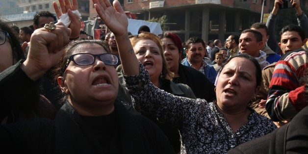 CAIRO, EGYPT - DECEMBER 12: People react during the funeral ceremony for the victims of the explosion at Saint Peter and Saint Paul Coptic Orthodox Church in Abbasiya district, at Church of the Virgin Mary in Nasr City neighborhood of Cairo, Egypt on December 12, 2016. (Photo by Ahmed Gamil/Anadolu Agency/Getty Images)