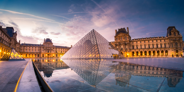 This photo of Louvre museum was taken during the sunrise of september. The pool water reflect their beautiful lights and architecture.