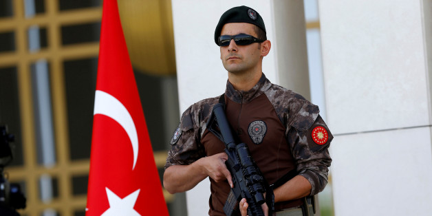 FILE PHOTO - A Turkish special forces police officer guards the entrance of the Presidential Palace in Ankara, Turkey, August 5, 2016. REUTERS/Umit Bektas/File Photo