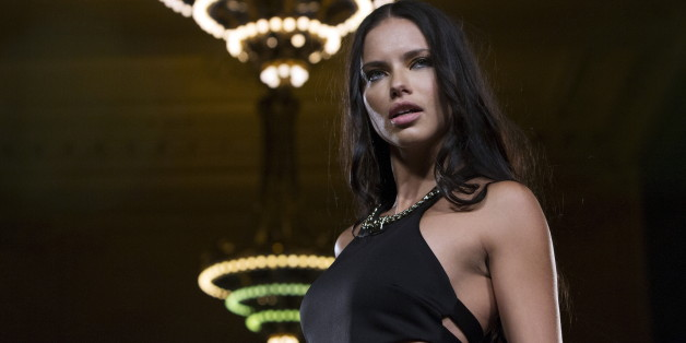 Model Adriana Lima presents a creation from Carmen Steffens during the FTL Moda presentation of the Spring/Summer 2016 collection during New York Fashion Week in Vanderbilt Hall at Grand Central Station, New York, September 13, 2015. FTL Moda presented a range of designers and partnered with the Christopher & Dana Reeve Foundation and Global Disability Inclusion. The show casted a diverse range of models, including models living with disabilities. REUTERS/Andrew Kelly