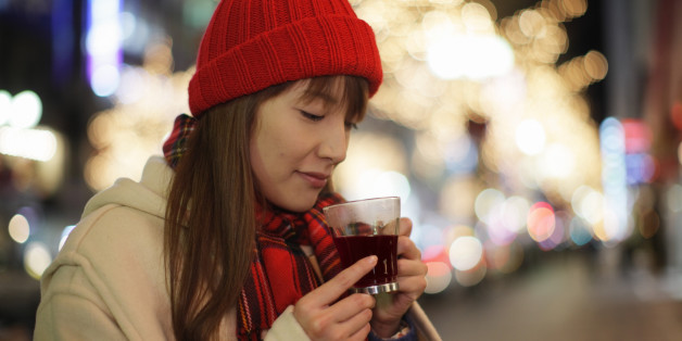 Woman drinking hot wine