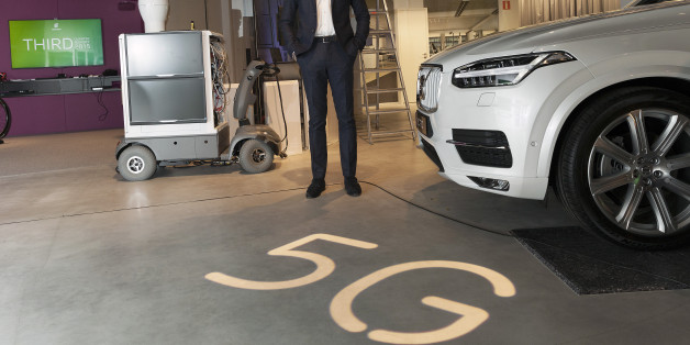 Hans Vestberg, chief executive officer of Ericsson AB, poses for a photograph beside a 5G base station prototype, left, and a Volvo Cars XC90 automobile, following an earnings news conference in Kista, Sweden, on Friday, Oct. 23, 2015. Ericsson AB reported third-quarter profitability and sales that missed analysts' estimates as business in Japan, Russia and Brazil slumped and spending slowed in China on fourth-generation networks that power smartphones and tablets. Photographer: Johan Jeppsson/B