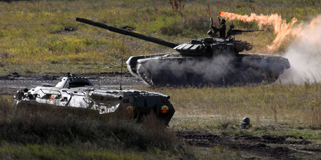 CHEBARKUL, RUSSIA - SEPTEMBER 27:  Russian army tanks participate in the Center-2011 military exercises September 27, 2011 in Chebarkul, Chelyabinks region, Russia.  According to reports September 27, 2011, Russian President Dmitry Medvedev said that if anyone in government questioned his plan to boost defense spending must work elsewhere. The Russian President fired the Finance Minister Alexei Kudrin September 26, after criticizing his military budget publicly.  (Photo by Sasha Mordovets/Getty Images)