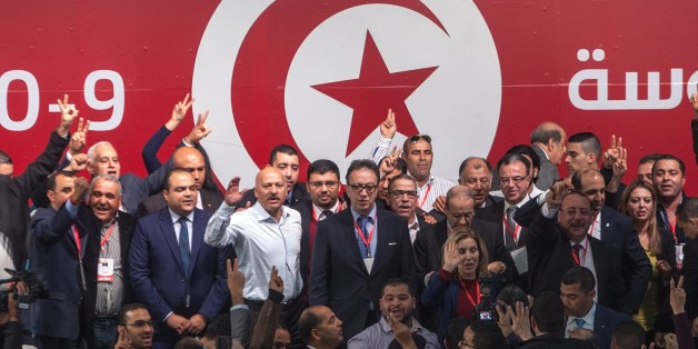 TUNIS, TUNISIA - JANUARY 10:  Hafedh Caid Essebsi (C), new President of Tunisia's ruling Nidaa Tounes party and son of the Tunisian President Beji Essebsi, poses with the supporters during a media conference on January 10, 2016, in Tunis, Tunisia. (Photo by Amine Landoulsi/Anadolu Agency/Getty Images)
