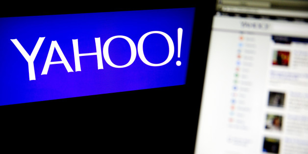 The Yahoo! Inc. logo and website are displayed on laptop computers in this arranged photograph in Washington, D.C., U.S., on Tuesday, April 15, 2014. Yahoo! Inc. expected to release earnings figures after the market close on April 15. Photographer: Andrew Harrer/Bloomberg via Getty Images